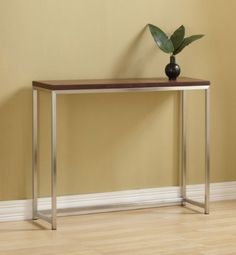 Tag Furnishings 390109 Group Ogden Console Entry Table, Safari by Tag. $345.00. Size:10' x 36', Finish:Safari  Ogden Console Table   Thinner profile frame perfect for smaller spaces  Frames are 3/4' brushed stainless steel tube  Wood top is 1' thick veneered  Corners are smooth and absolutely seamless