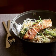 Crisp Asian Salmon with Bok Choy and Rice Noodles | Patrick Dunlea was booted off Top Chef Season 5's first episode because his salmon and bok choy were lackluster and his black-rice noodles were mushy. Gail Simmons amps up the broth with soy sauce, rice wine vinegar, ginger and garlic and uses white-rice noodles instead of black (they're easier to find), cooked briefly to keep their texture firm.