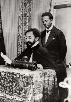 Frost House, Empire of Abyssinia (Ethiopia).  Negus Haile Selassie sitting at a table while he runs through papers during the Italo-Abyssinian oorlog.Addis Ababa, Abyssinia (Ethiopia), 1934
