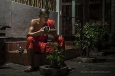 """Studying by Night - Portrait of a monk (Laos). Visit http://robertopazziphotography.weebly.com subcribe to the newsletter and download the ebook """"Streets of the World"""" as welcome gift! Web Site: http://robertopazziphotography.weebly.com/ Facebook: Roberto Pazzi Photography Instagram: Roberto_Pazzi_Photography"""