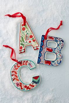Discover holiday ornaments at Anthropologie. Shop unique ornaments from animal ornaments, monogram ornaments and more. Clay Ornaments, Holiday Ornaments, Ornament Wreath, Noel Christmas, Handmade Christmas, Christmas Stockings, Ceramic Christmas Decorations, Ideias Diy, Christmas Inspiration