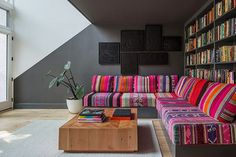 """An important reminder, courtesy of designer Chelsie Lee of Jessica Helgerson Interior Design: Don't forget to play. """"We love this lower-level family room and the way it connects to the kitchen above through the playfully angled paint line,"""" she says. As for that prismatic sectional sofa? """"We collected 18 vintage Peruvian blankets to make it."""" #refinery29 http://www.refinery29.com/cool-rooms-nyc-apartment-pictures#slide-7"""