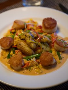 Pan Seared Sea Scallop entrée with lobster succotash & warm fingerling potato salad.