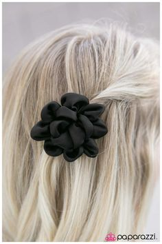 Classical Music  Plush black satin petals curl into an elegant blossom. The soft satin petals shimmer in the light for an added dash of romance. Features a standard hair clip on the back.  Sold as one individual hair clip.