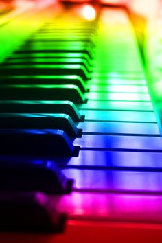 The progressive change of the colors also represents the slow change to higher notes on the piano.  The reflection of a source of sunlight in the piano keys and the back of the picture display the strong colors (that may get out of control) that hit you as you see a rainbow.