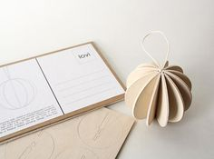 Finnish designer Anne Paso designed the Lovi Ball for Lovi as a flat-packed postcard that you assembly into an adorable wood sphere that's perfect for a tree. via design milk Modern Christmas, Christmas Holidays, Christmas Crafts, Christmas Decorations, Christmas Ornaments, Christmas Tables, Purple Christmas, Coastal Christmas, Christmas Stuff