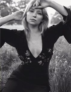 Actress Haley Bennett poses in Dior dress with v-neckline