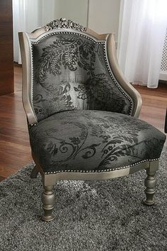 old chair re-covered in modern fabrics, at Rose cottages and gardens