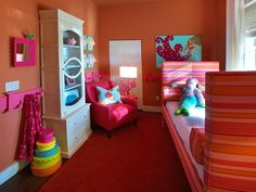 Rather than choosing a traditional color palette for this girl's room, designer Linda Woodrum goes for something a little more modern and daring. A combination of bright orange and hot pink creates a vibrant and lively design that also fits in with its tropical surroundings. Although these colors are side by side on the color wheel, they look stunning together.