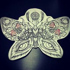 Love the moth, but different inside designs.