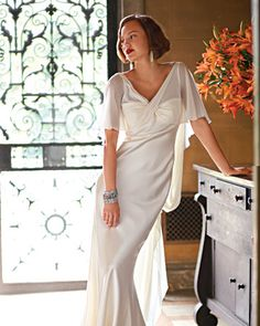 """Art Deco Wedding Dress  A bias-cut silk satin gown is striking in its simplicity. This one has an especially flattering feature: blousy silk georgette cape sleeves that cross over the chest and flutter down the back, Greek goddess-style. The Details: Peter Langner """"Xantia Due"""" gown (Roma Sposa, 248-723-4300)."""