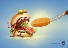 This is a great example of an advertisement that grabs your attention with a strong image. The illustration of the hungry bun monster draws attention with humor. The ad has effective direction with the tongs diagonally holding the patty and the bun has eyes that look in the direction of the advertised patty. Then the eye is drawn to the logo and ad message. The illustration is isolated against a solid background, while the patty stands out with a subtle bright gradient behind it.