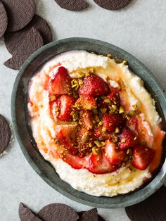 Roasted Strawberries on Whipped Ricotta...keep it a bit more savory (less honey, add tarragon to the ricotta?). Serve with crusty bread toasts rubbed with orange peel...