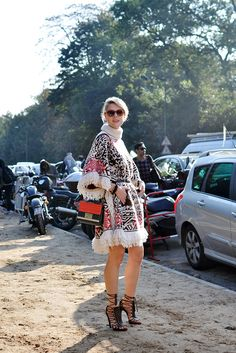 Belgium blogger Sofie Valkiers. Sofie is wearing Emilio Pucci dress and lace up sandals, Louis Vuitton bracelet and Elie Saab bag