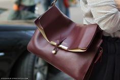 http://i1227.photobucket.com/albums/ee428/tuxifandecos/stockholm-street-style-celine-burgundy-bag-black-cream-1.jpg