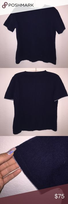 Burberry Soft Wool Short Sleeve Top Size XL, in excellent condition! No flaws. Colors are Navy with light grey trim. Burberry logo also in Navy. Item is Wool. Swoop Neck style. Feel free to ask any questions! Offers thru offer button only, no trades sorry! Burberry Tops