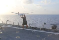 Unmanned aerial vehicle (UAV) aerial pilot and maintenance specialist, prepares to launch the Puma (RQ-20) into flight operations aboard the USNS Spearhead (JHSV 1) for Fleet Experimentation period two of Southern Partnership Station 2015 (SPS-JHSV 15), July 18. US Navy photo.