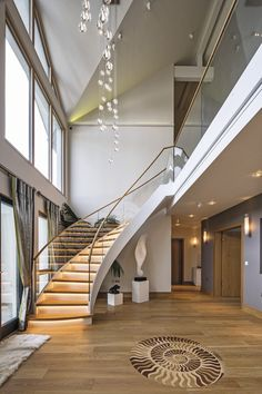 Double Height Entrance And Sweeping Staircase Makes For Grand Statement To  Guests And Residents Alike