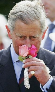 Smells like spring! Prince Charles smelled a flower presented to him during the unveiling of the garden dedicated to the Queen Mother at the Royal Botanic Gardens.