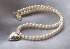 Lovely necklace in 6mm freshwater Pearls, fine silver 22mm hammered heart from Karen HIll Tribe, can also be made in gold plated on sterling (gold filled). All other silver used 925 sterling.