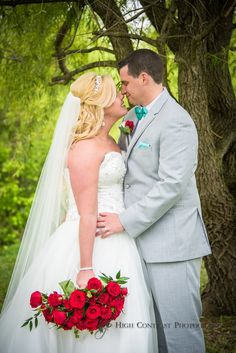 Wedding photo taken by High Contrast Photography #weddingphoto #love #kissme #forever #teal&redwedding #teal #redroses #red #roses