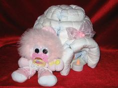 """Diaperzoo.com Diaper cake instructions, baby gifts, baby shower, center piece, babies, shower ideas,"""""""