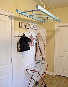 Do this instead of the wall mount version!  Old Ladder in a laundry room to hand drying clothes......... Great idea!  I like this for a pot pan rack in kitchen for a rustic style  mine would be red white and blue americana colors