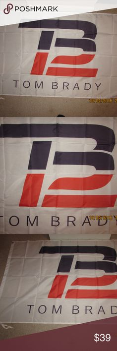 TB12 Tom Brady New England Patriots Flag Banner An Awesome Tom Brady of The New England Patriots TB12 3x5 Feet Flag for your Man Cave, Bar, Garage, Bedroom, Dorm Room, Office, Tailgate Party, etc for indoors or outdoors. Has 2 Metal Grommets for attaching to flag pole. See last pic of the back of the flag. Brand New in Package Pro Football Accessories
