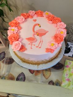 OH MY GOODNESS flamingo mama and baby baby shower cake with gold sprinkles at the bottom