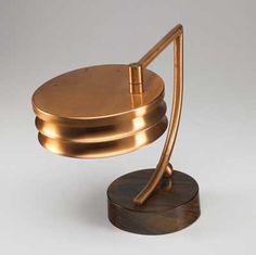 WALTER VON NESSEN Copper table lamp with swing-out shade on faux-bois metal base. 11 1/2