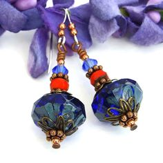 If cobalt blue is a favorite color, the bewitching BEAUTIFUL IN BLUE handmade earrings are a must for your ears. The one of a kind dangle earrings feature rich blue Czech glass rivoli (bicone) beads.