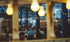 Diners in a warehouse at the Big Feed, Glasgow's first regular street food party.