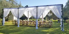 What a beautifully simple use of pipe and drape for an outdoor event--the sheerness of the fabric really helps keep the decor light and breezy. Lovely! Draping Shade Outdoor Event Furniture Rental Tables Chairs