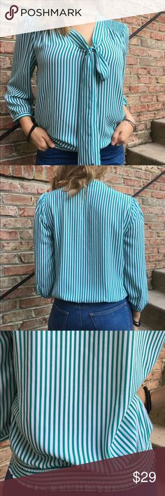 The Limited Green and White Striped Blouse Worn once. Striped green and white blouse by the limited. Made of polyester. Has a front tie ribbon. Reasonable offers considered through offer button only The Limited Tops Blouses