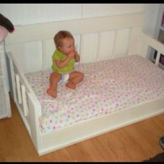 When my daughter out grew her baby crib but Mommy was not ready for the toddler bed she called on Daddy to find a solution. So my husband made a toddler mattress size day bed that he painted white and that sat on the floor that way if she ever were to fall it would not be so far