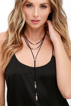 "Cool girls unite! The on-trend Lasso Good Gold and Black Choker Necklace is exactly what you've been waiting for, with a layered bolo style made from vegan leather strands, decorated in gold beads and feather charms. Shortest strand measures 14"" around with a 3.5"" extender chain."