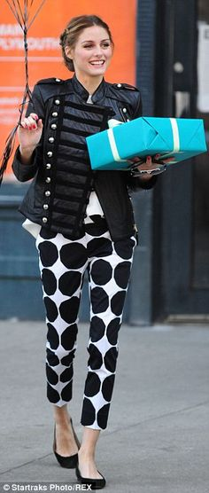Chic style: The fashion icon paired her kivet print Marimekko trousers with a military-style jacket... Olivia Palermo