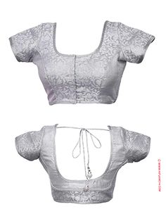 RENT : Glittering Silver Ready to Wear Blouse.  Elegant design that will enhance the look of your saree. This blouse is designed with different patterned brocade fabrics with a princess cut, enhanced with glittering silver border lace work. The blouse has a back knot string with hanging tassels. The sleeve length is 5 inches with blouse length 13 inches from the shoulder. Flaunt your party wear by matching your saree with this splendid design.