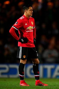 Alexis Sanchez Photos - Alexis Sanchez of Manchester United during The Emirates FA Cup Fourth Round match between Yeovil Town and Manchester United at Huish Park on January 26, 2018 in Yeovil, England. - Yeovil Town v Manchester United - The Emirates FA Cup Fourth Round