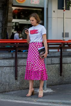 Dress down a skirt with easy mules and a t-shirt for casual vibes that speak to Summer.