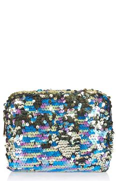 A multitude of sequins in a kaleidoscope of colors covers this zip-top cosmetics bag that really sparkles and shines.