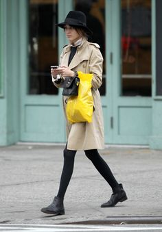 black boots and tights with trench