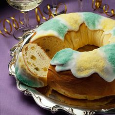 Decorated in traditional Mardi Gras  green and yellow, King's Cake is first served on January 6, Twelfth Night. Whoever is served the hidden pecan becomes the king or queen for the week and bakes another King's Cake. This festive ritual continues each week until Mardi Gras, the day before Lent.
