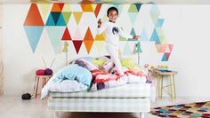 Triangle / colors geometric forms in a kid bedroom ! Great idea! <3