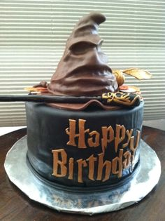 Harry Potter Sorting Hat Birthday Cake – Hat is RKT. Everything else is covered in chocolate MMF. Harry Potter Sorting Hat Birthday Cake – Hat is RKT. Everything else is covered in chocolate MMF. Bolo Harry Potter, Gateau Harry Potter, Harry Potter Sorting Hat, Harry Potter Birthday Cake, Harry Potter Food, Harry Potter Wedding, Harry Potter Theme Cake, Harry Potter Party Decorations, Birthday Cake Decorating