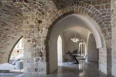 Image 44 of 71 from gallery of Old Jaffa House 4 / Pitsou Kedem Architects. Photograph by Amit Geron Old Jaffa, Dream Background, Pitsou Kedem, Brick And Stone, Contemporary Interior, Modern Interior Design, Lodges, Glass Door, Interior Architecture