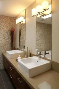 (1) raised square sinks (2) mosaic tiled accent wall