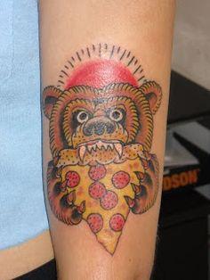 Bear eating pizza