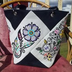 Tote bag by Pat; blackwork bloom designs by Embroidery Library