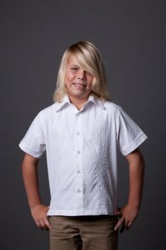 """http://theguayaberashirtstore.com  For kids ages four through twelve.  Our Kids J. Edwards """"Latin"""" embroidery shirt is made from 100% """"pinpoint cotton oxford"""".  This design is patterned after the traditional Guayabera as worn in Mexico and Latin America.  It features a beautiful embroidery pattern on the front of the shirt, no pockets and a vented hem."""